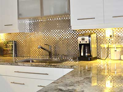 Metal backsplash tiles installed by TLC Tile Pros Tampa