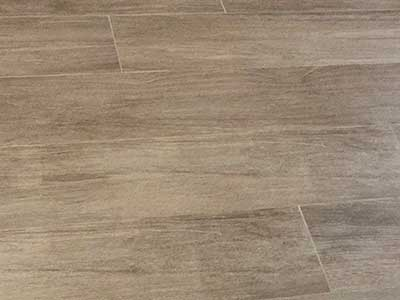 Ceramic floor tiles faux wood installed by TLC Tile Pros Tampa