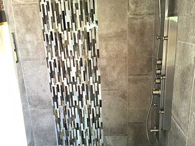 Decorative glass tiles installed by TLC Tile Pros Tampa