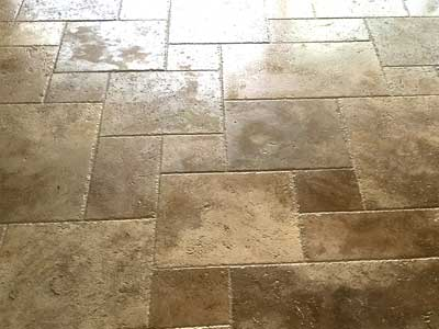 Travertine floor tiles installed by TLC Tile Pros Tampa